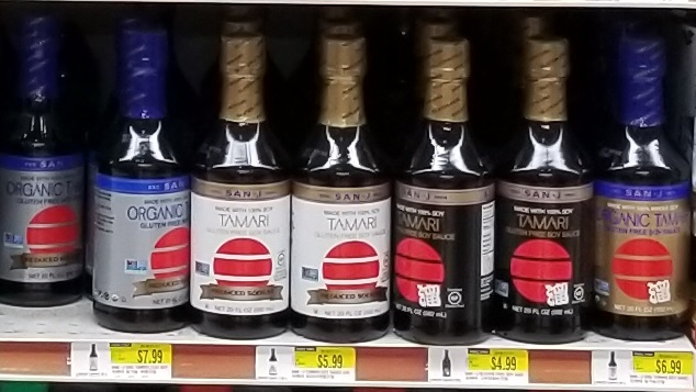 market shelf with several different kinds of San-J tamari soy sauce