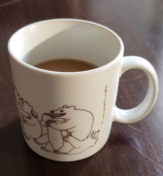 Coffee in a mug covered with frolicking bears, followed by the quoted caption: Look for the bare necessities The simple bare necessities Forget about your worries and your strife I mean the bare necessities That's why a bear can rest at ease With just the bare necessities of life
